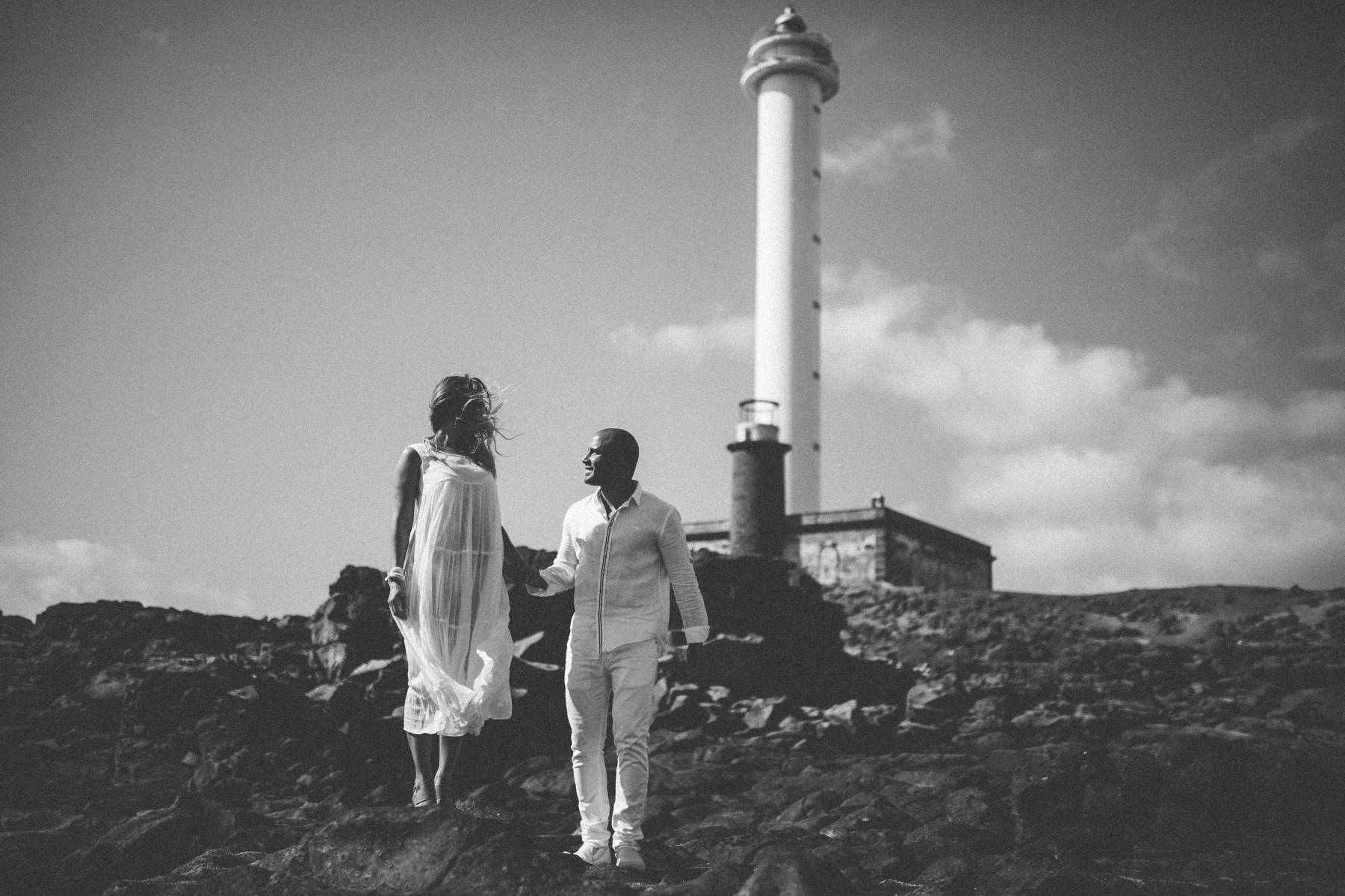 Bride and groom under the lighthouse