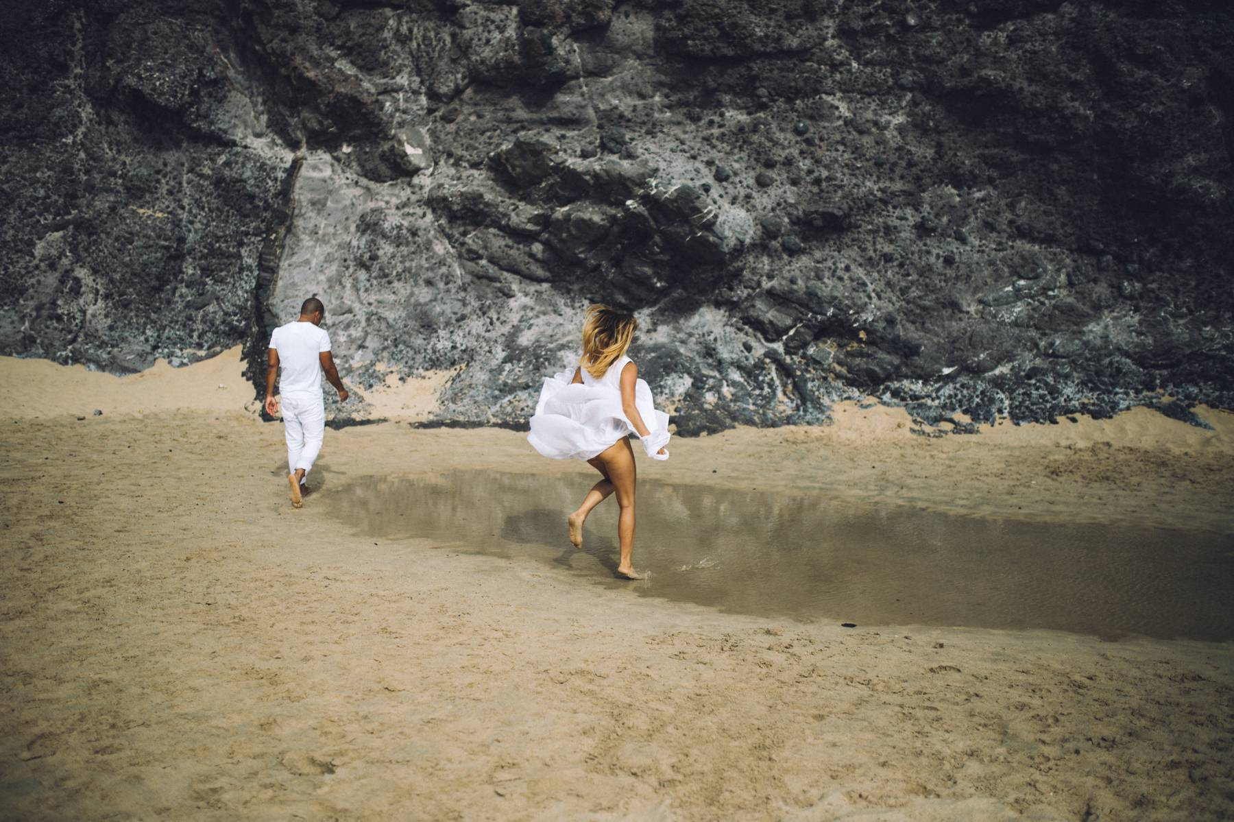 Bride running on sand